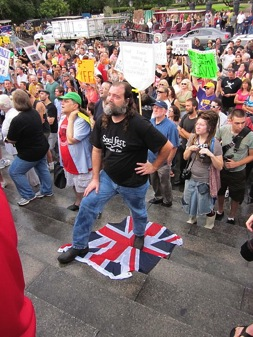 BP Protester stand on the Union Jack
