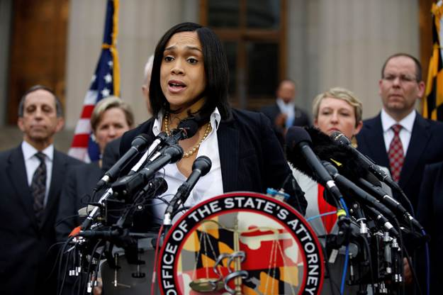Marilyn Mosby, Baltimore state's attorney, announces criminal charges Friday against all six officers suspended after Freddie Gray suffered a fatal spinal injury while in police custody.  (Alex Brandon/AP)