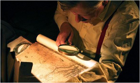 Description: A reconstruction of Herman Wirth looking at map for Atlantis