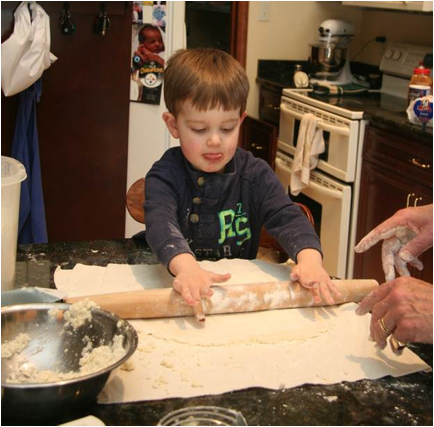 Description: Jack rolling out the dough