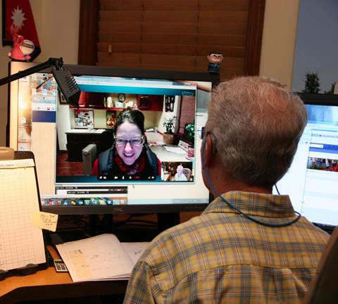 Al talking to China on Skype