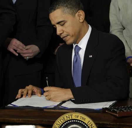 Obama signs the healthcare legislation into law