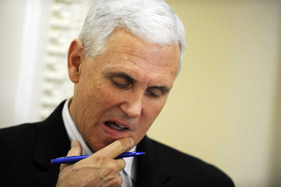 U.S. Representative Mike Pence (R-IN) looks at his notes before a news conference about the goal of permanently extending Bush-era tax rates at the U.S. Capitol in Washington December 2, 2010. Pence told reporters on Thursday his view on stripping the Fed