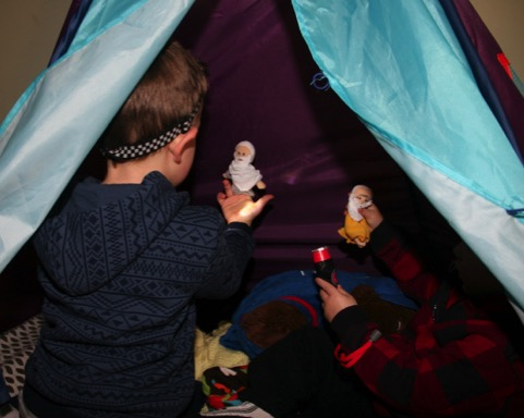 Jack and Owen playing in their tent with tent