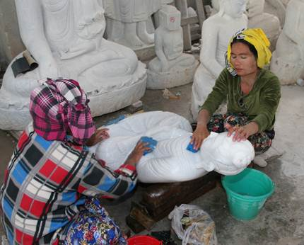 Women working on statues