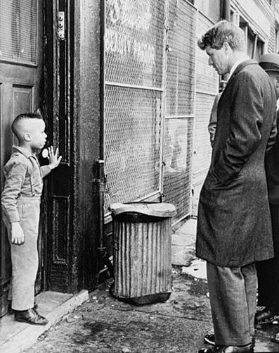 Robert F. Kennedy confronting racism and poverty.