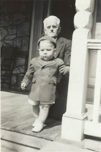 Al with his grandfather on the porch